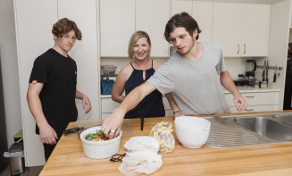 Karen Porter with her two boys Cameron Morris and Lachie Morris, at their Fairlight home where they share the chores.
