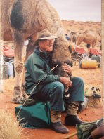 Wilkinson in the Simpson Desert in 2006 with one of his camels.
