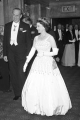 Queen Elizabeth II arrives at the Odeon, Leicester Square, London, for the world charity premiere of the film Lawrence of Arabia in 1962.