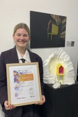 Lourdes Hill College graduate Emilia Memory, 18, with her artwork that is being showcased in a virtual exhibition at GOMA.