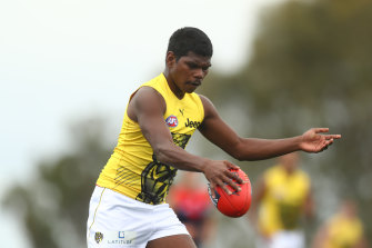 Maurice Rioli in action on Friday.