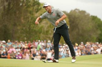 Adam Scott of Australia celebrates winning the PGA Championships at RACV Royal Pines on Sunday.