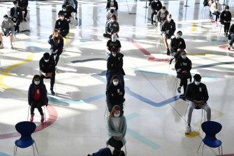 Year 12 students begin to get their Pfizer vaccinations at the hub at Homebush