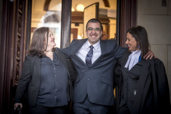 Faruk Orman, with his lawyers Ruth Parker, left, and Carly Lloyd, right, on the steps of the Supreme Court after his release from prison.