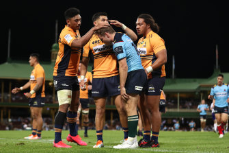 Will Harrison of the Waratahs is consoled by Brumbies players after missing a conversion to draw the game.