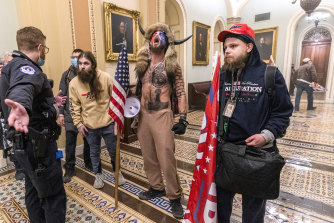 Supporters of President Donald Trump are confronted by Capitol Police officers outside the Senate Chamber.