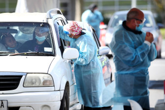 A nurse completes a COVID-19 test at the Mangere Town Centre testing centre in South Auckland on Tuesday.