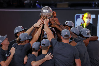 The Heat celebrate with their trophy.
