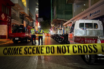 Maldivian police secure the area following the blast in Male, Maldives, on Thursday night.