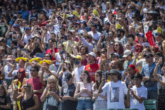 Fans cheer at the Nathan's Famous Fourth of July International Hot Dog-Eating Contest in Coney Island's Maimonides Park.