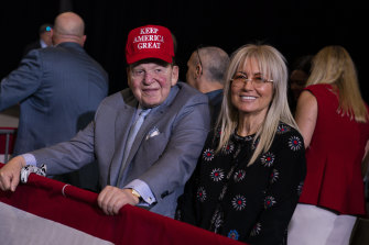Sheldon Adelson and his wife Miriam await the arrival of President Donald Trump at a campaign rally in Las Vegas last year.