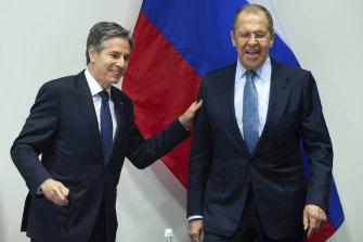 US Secretary of State Antony Blinken, left, greets Russian Foreign Minister Sergey Lavrov.