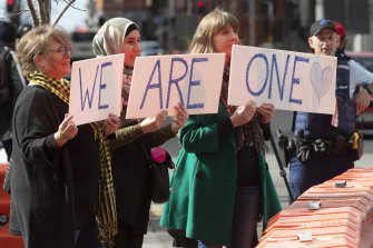 Supporters of the mosque shooting survivors hold signs of support outside the Christchurch High Court after the sentencing of Australian Brenton Harrison Tarrant in Christchurch last year.