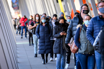 People queue up for COVID-19 vaccinations at the Melbourne Convention and Exhibition Centre.