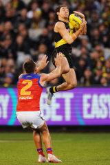 Up and at 'em: Daniel Rioli flies high for Richmond.