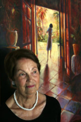 Jan Ruff O'Herne, pictured in 2008 with a painting by her daughter Carol Ruff showing Jan trying to escape from a Japanese brothel.