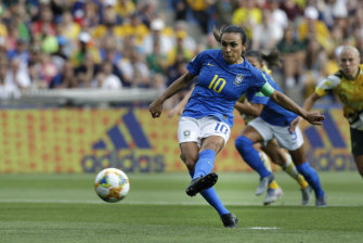 Marta scores from the spot for Brazil.
