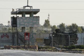 A Turkish military armoured vehicle fires towards the Syrian town of Tal Abyad from the Turkish side of the border on October 12, 2019 in Akcakale, Turkey.