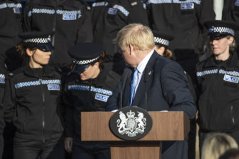 A student officer behind Prime Minister Boris Johnson nearly fainted during his press conference.