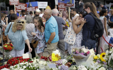 Londoners lay flowers after a minute's silence on London Bridge on Sunday.