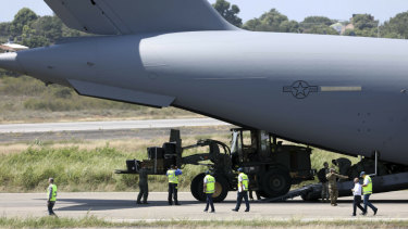 A loader disembarks from A United States Air Force C-17 cargo plane loaded with humanitarian aid, after it landed at Camilo Daza airport in Cucuta, Colombia, on Saturday.