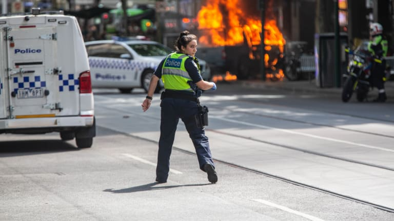 A police officer at the scene of the Bourke Street attack.