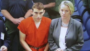 A video monitor shows school shooting suspect Nikolas Cruz, in a brief court appearance on Thursday.