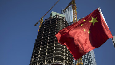 A Chinese flag flying in Beijing's CBD: China is making swift advances with an elaborate system for measuring the social creditworthiness of companies.