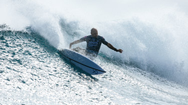 Champion surfer Kelly Slater competes at Margaret River on Friday. Competitors were taken from the break on jet skis on Sunday after a shark was spotted just before 4pm local time.