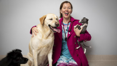 Dr Anne Fawcett with dogs Labrador Ned Notting, pomeranian cross maltese Archer Van Golde and italian greyhound Nino Thompson-Hunt.