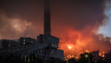 Fires burn at the back of the Kemerkoy Thermal Power Plant in Mugla, Turkey.