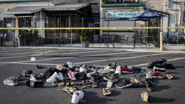Shoes are piled outside the scene of a mass shooting in Dayton, Ohio in August, in which nine people were killed.