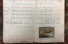 Log book with entry by rear gunner Ray Wilkinson.