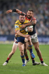 Nathan Brown is tackled by Jared Waerea-Hargraves.
