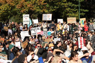 Protesters gather in Melbourne's Treasury Gardens for a climate rally on Friday.