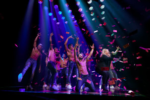 Performers alongside MC Amy Ingram on stage in Magic Mike Live in Melbourne