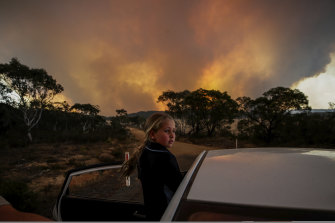 A child from Braidwood watches the North Black Range bushfire in November last year.