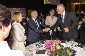 Prime Minister Scott Morrison greets(from left to right) Susan Lloyd-Hurwitz (head of Mirvac), Andrew Penn (Telstra) and Alison Watkins (Coca-Cola Amatil) at the Business Council of Australia's annual dinner.