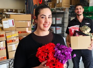 Staff members Caris and David Fischetti  at The Military Shop in Canberra, which supplies poppies to RSL clubs.