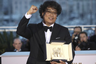 Globe frontrunner: Director Bong Joon-ho with his Palme d'Or award for the film Parasite.