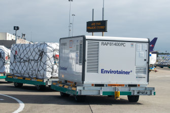 The first vials of the AstraZeneca COVID-19 vaccine arriving at Sydney Airport on Sunday morning.