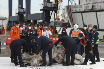 Rescuers inspects objects found in the waters around the location where a Sriwijaya Air passenger jet lost contact with air traffic controllers shortly after the takeoff, at Tanjung Priok Port in Jakarta on Sunday.