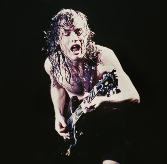 Guitarist Angus Young shreds a solo during a concert on October 18, 1985, at the Forum in Inglewood, California.