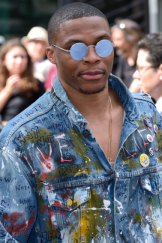 NBA star Russell Westbrook 'self-expresses' at Paris Fashion Week.