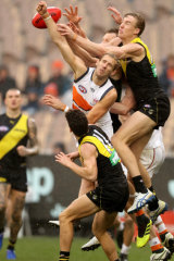 Up and about: Richmond forward Tom Lynch leaps for a mark against the Giants.