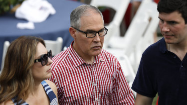 Scott Pruitt, centre, and his wife Marlyn Pruitt, left, attend a picnic for military families in Washington on Wednesday.