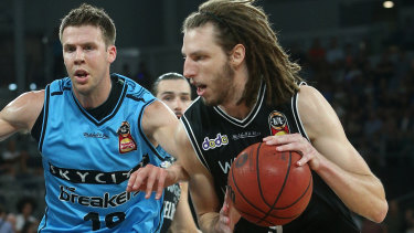 United's Craig Moller drives against Tom Abercrombie of New Zealand.