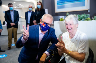 Holy Family Services resident Jane Malysiak appeared with the Prime Minister after she became the country's first COVID-19 vaccine recipient.