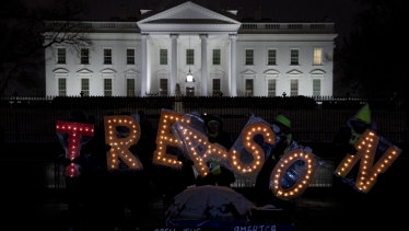 Demonstrators make their point  outside of the White House on Saturday.