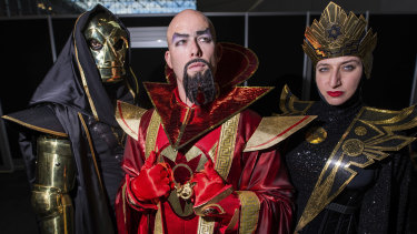Who can save them now? Fans dressed as Klytus, Ming and Kala from Flash Gordon.